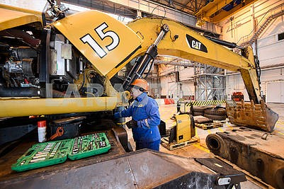 Excavator in the repair shop