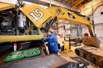 Excavator in the repair shop