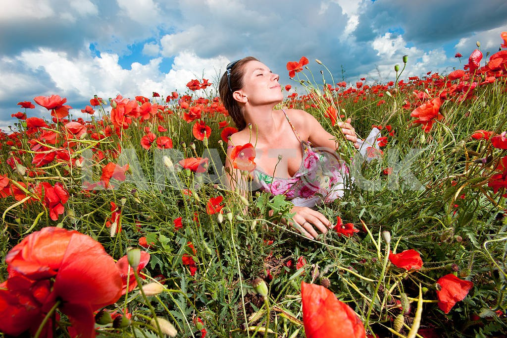 Girl in a field of poppies — Image 6405