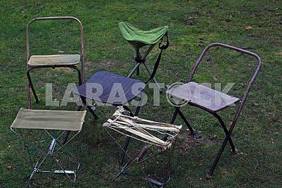 Folding tourist chairs