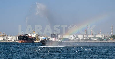 Tugboat in the water area of ​​the port of Dubai