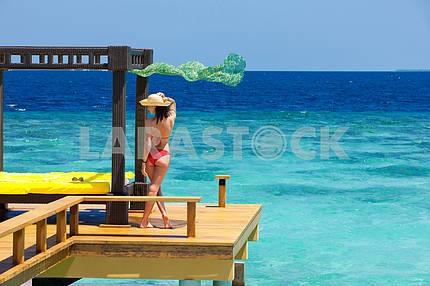 Beautiful girl in bikini onbackground of ocean