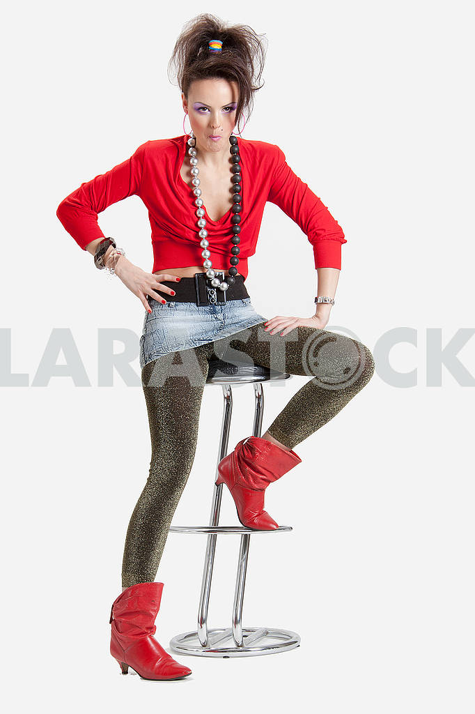 Picture of a young playful lady on a high chair — Image 64428