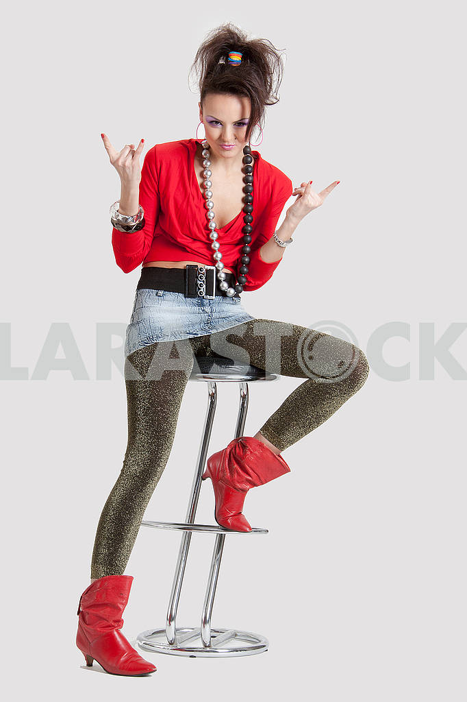 Picture of a young playful lady on a high chair — Image 64447