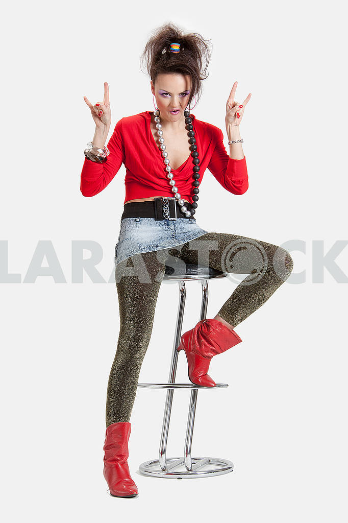 Picture of a young playful lady on a high chair — Image 64448