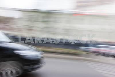 Автомобили на размытом фоне