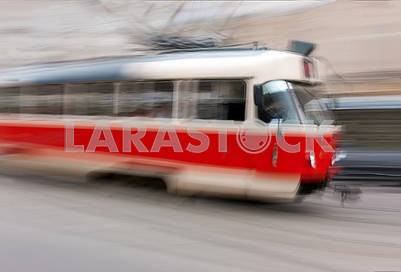 Red trolley car in the city