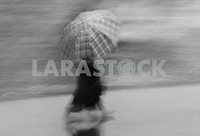 Woman walking with umbrella