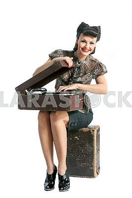 beautiful girl and old gramophone, on white background in studio