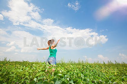 Beautiful young woman on a green meadow