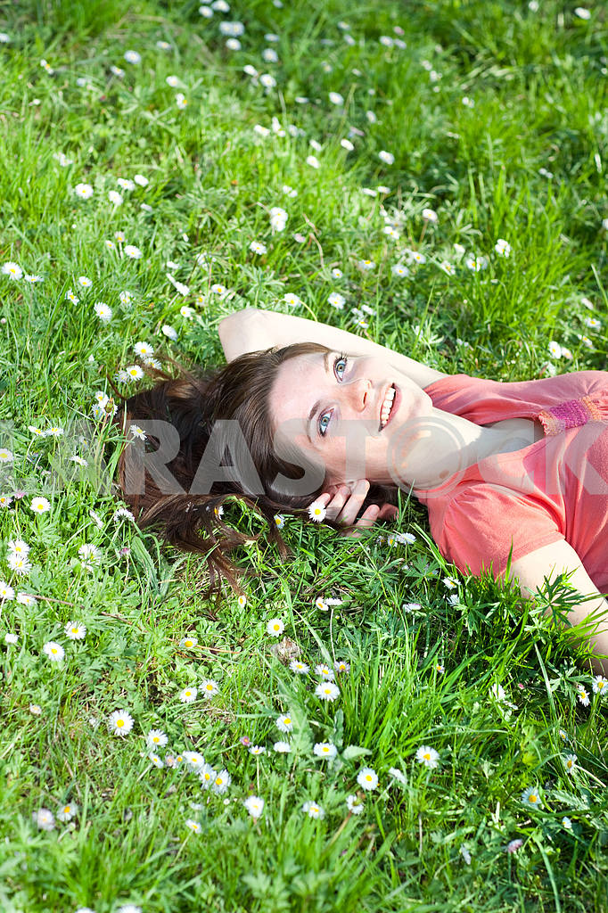 Smiling young woman in green grass — Image 6481