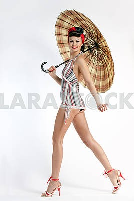 Pinup model with umbrella