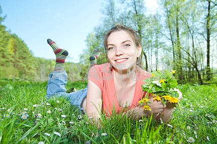 smiling young woman in green grass