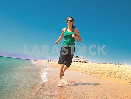 Girl running on beach