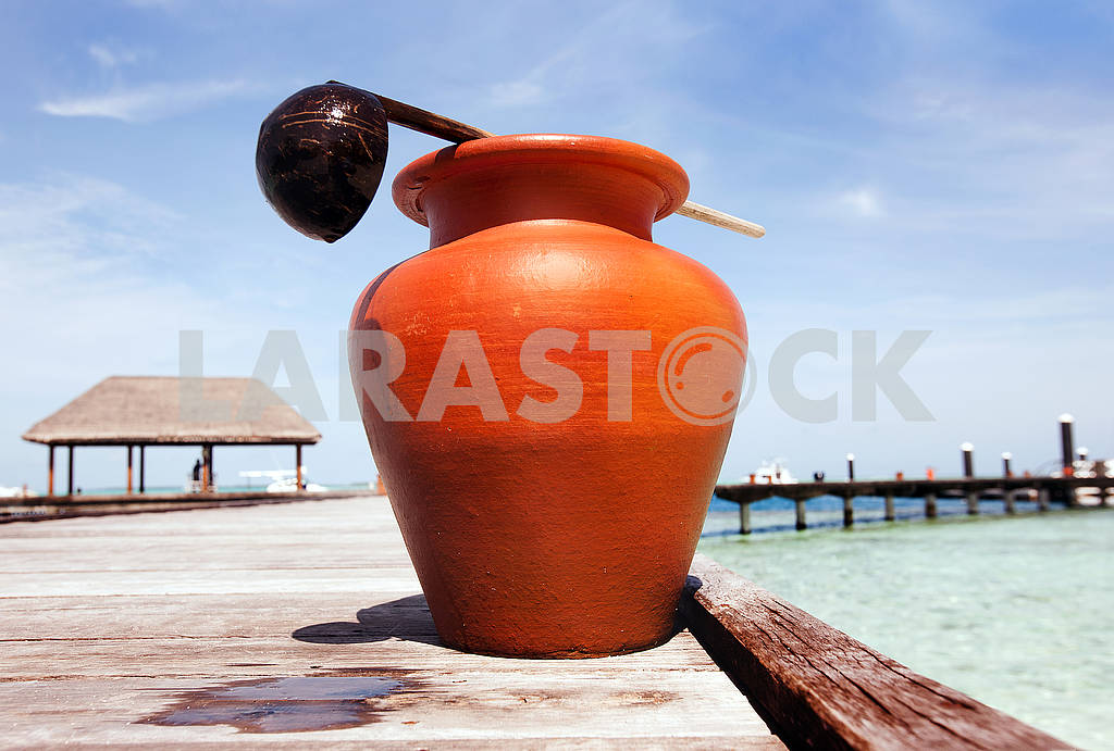 A jug of water on a wooden dock — Image 64992