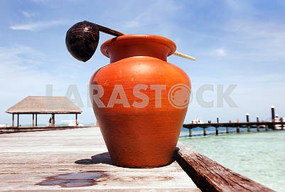 A jug of water on a wooden dock