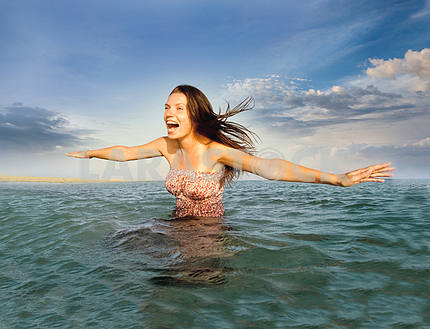 Portrait of a beautiful girl in the sea