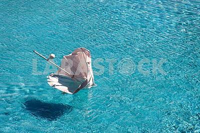 Beach umbrella swimming in the pool