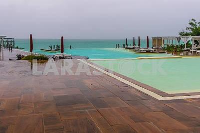 Swimming pool on the shores of the Indian Ocean