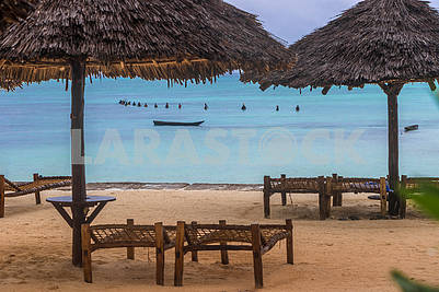 Sun beds and straw umbrellas