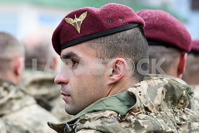 Marines wearing dark maroon berets