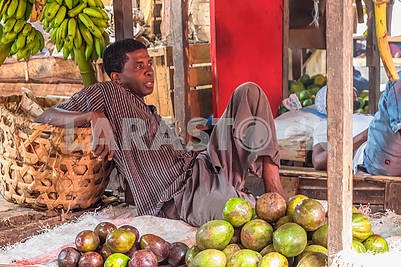 A man is selling fruit