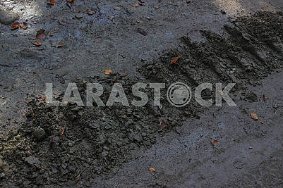 The track from the caterpillar tractor on a dirt road