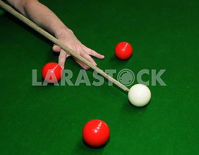Billiard balls and cue