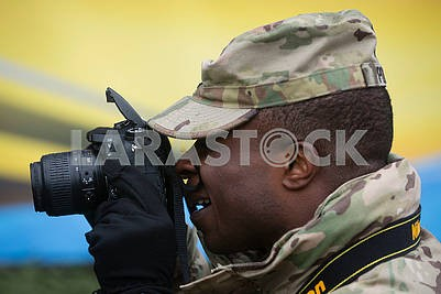 Black serviceman with camera