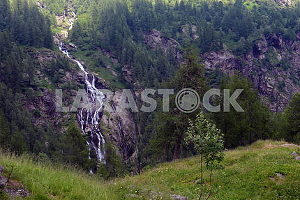Waterfall in the mountains in summer