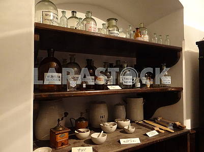 Shelves with bubbles and bottles in an old pharmacy.