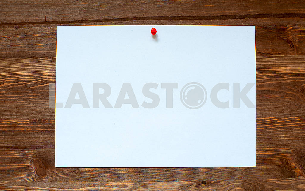 The white sheet on a wooden background. — Image 66322
