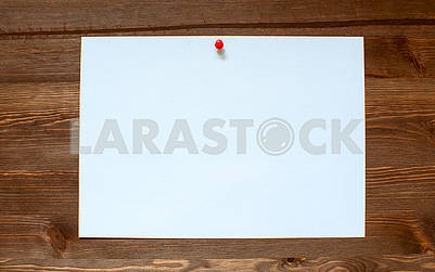 The white sheet on a wooden background.