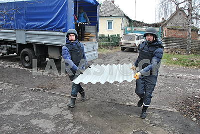 Rescuers carry slate