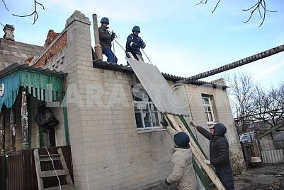Rescuers repair the house