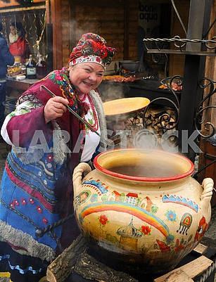 The woman near the cauldron