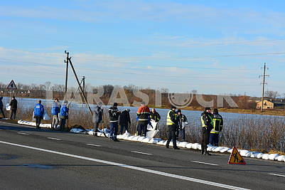 Rescuers lay bags on the road