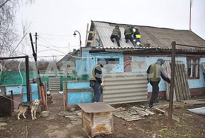 Rescuers restore the house