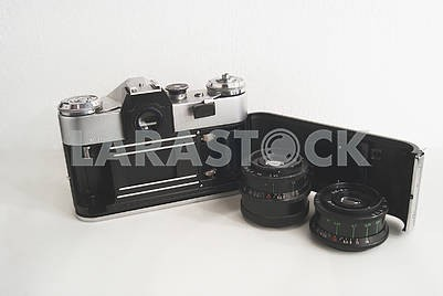 Old Soviet film camera with lens on white background close-up