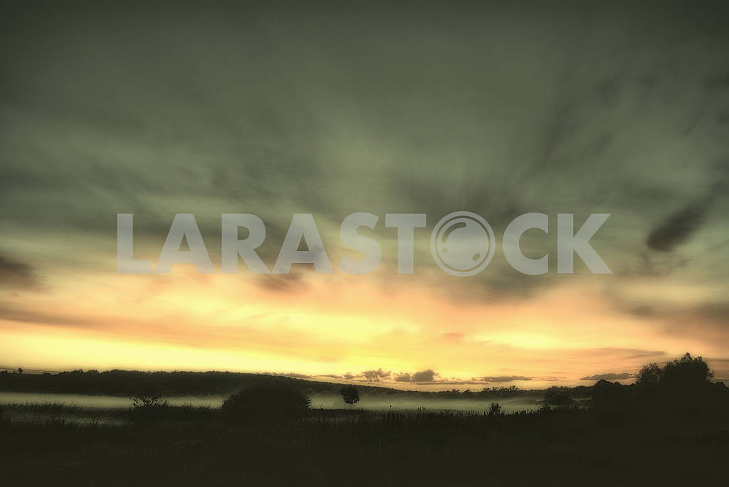 Evening mist over a hilly valley — Image 66945