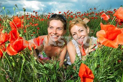 Two girls in a poppy field