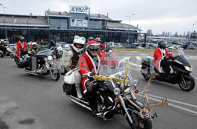 Festive motocross of Santa Claus and Snow Maiden