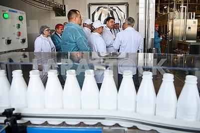 Conveyor with milk bottles