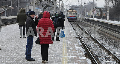 People stand on the platform