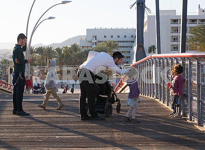Passers-by on the bridge in Eilat