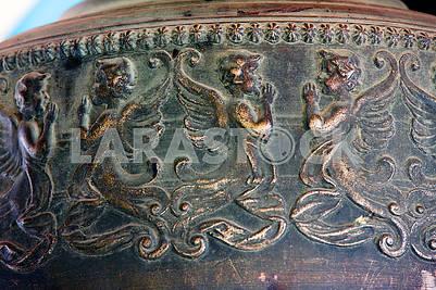 Bell bronze relief