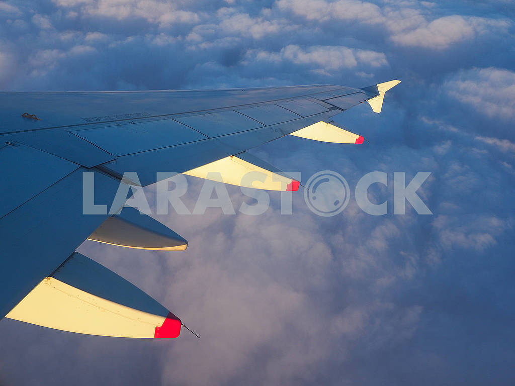 Wing of an airplane above the clouds — Image 68183