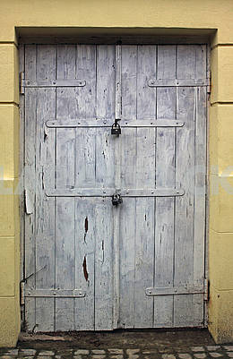 Old white dirty wooden front door