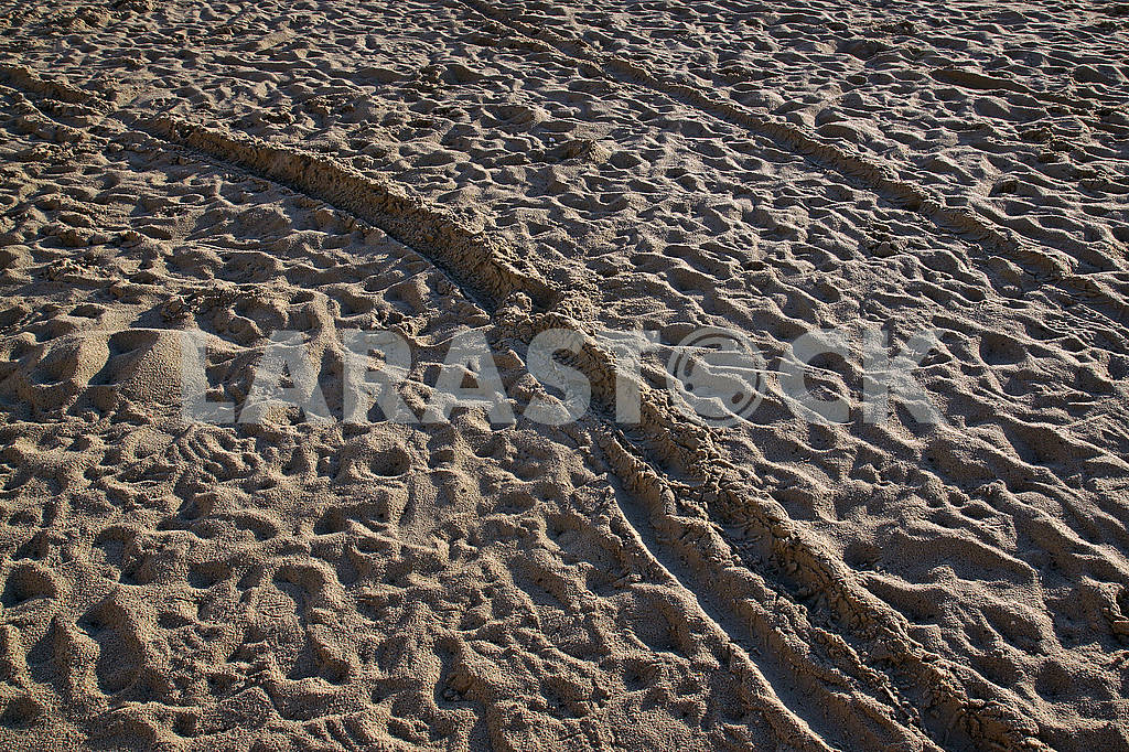 People trampled sand on the Mediterranean Sea beach in the morni — Image 68747