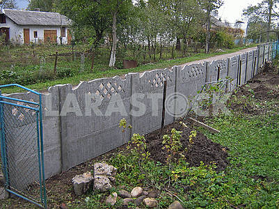 Long new grey concrete fence